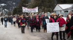 People participate in a solidarity march after Indigenous nations and supporters gathered for a meeting to show support for the Wet'suwet'en Nation, in Smithers, B.C., on Wednesday Jan. 16, 2019. (THE CANADIAN PRESS / Darryl Dyck)