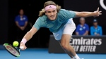 Greece's Stefanos Tsitsipas makes a forehand return to Switzerland's Roger Federer during their fourth round match at the Australian Open tennis championships in Melbourne, Australia, Sunday, Jan. 20, 2019. (AP Photo/Mark Schiefelbein)