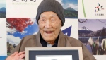 In this April 10, 2018, file photo, Masazo Nonaka smiles after receiving the certificate from Guinness World Records as the world's oldest living man at 112 years and 259 days during a ceremony in Ashoro on Japan's northern main island of Hokkaido. (Masanori Takei/Kyodo News via AP)
