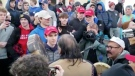 """In this Friday, Jan. 18, 2019 image made from video provided by the Survival Media Agency, a teenager wearing a """"Make America Great Again"""" hat, centre left, stands in front of an elderly Native American singing and playing a drum in Washington, D.C. (Survival Media Agency via AP)"""