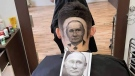 Barber Mario Hvala created this portrait of Russian President Vladimir Putin in a man's hair. (Mario Hvala via Storyful)