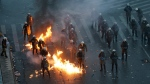A molotov cocktail explodes next to Greek riot police during clashes after a rally in Athens, Sunday, Jan. 20, 2019. Greece's Parliament is to vote this coming week on whether to ratify the agreement that will rename its northern neighbor North Macedonia. Macedonia has already ratified the deal, which, polls show, is opposed by a majority of Greeks. (AP Photo/Thanassis Stavrakis)