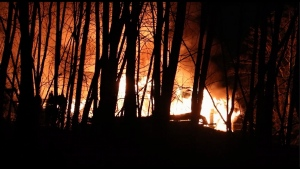 The fire broke out shortly before 8 p.m. Saturday night on Pinehurst Drive near the Kinder Morgan tank farm. (CTV)