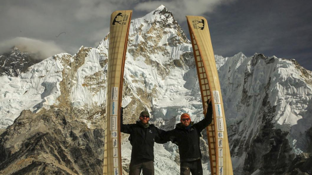 Two Canadians portage canoes up Mount Everest