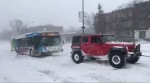 The bus was stuck in the snow on Pie XI Blvd during a snow storm.