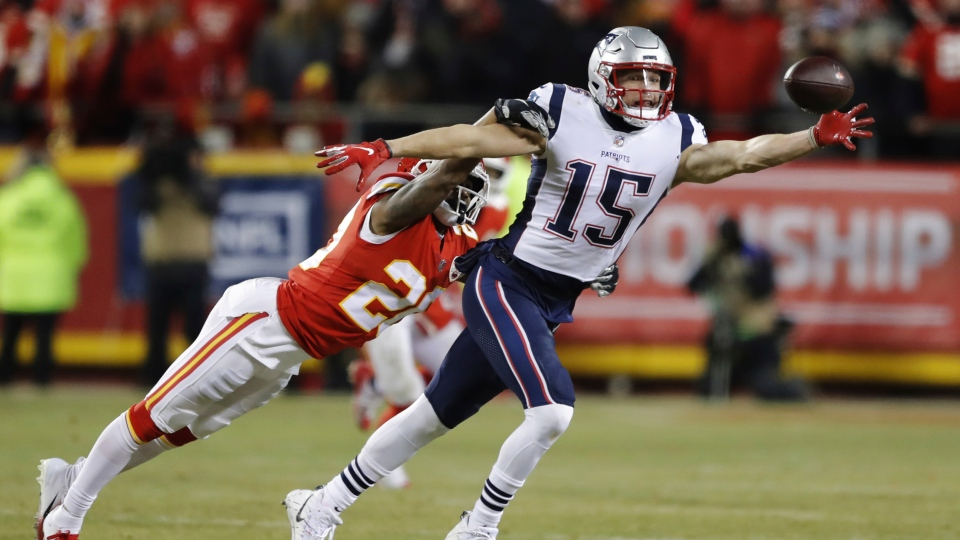 New England Patriots wide receiver Chris Hogan (15) reaches for the ball against Kansas City Chiefs cornerback Steven Nelson (20) during the second half of the AFC Championship NFL football game, Sunday, Jan. 20, 2019, in Kansas City, Mo. (AP Photo/Charlie Neibergall)