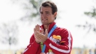 Canada's Adam van Koeverden accepts his bronze medal for the K1 1000m final at the 2015 Pan Am Games in Welland, Ont., Monday, July 13, 2015. THE CANADIAN PRESS/Aaron Lynett
