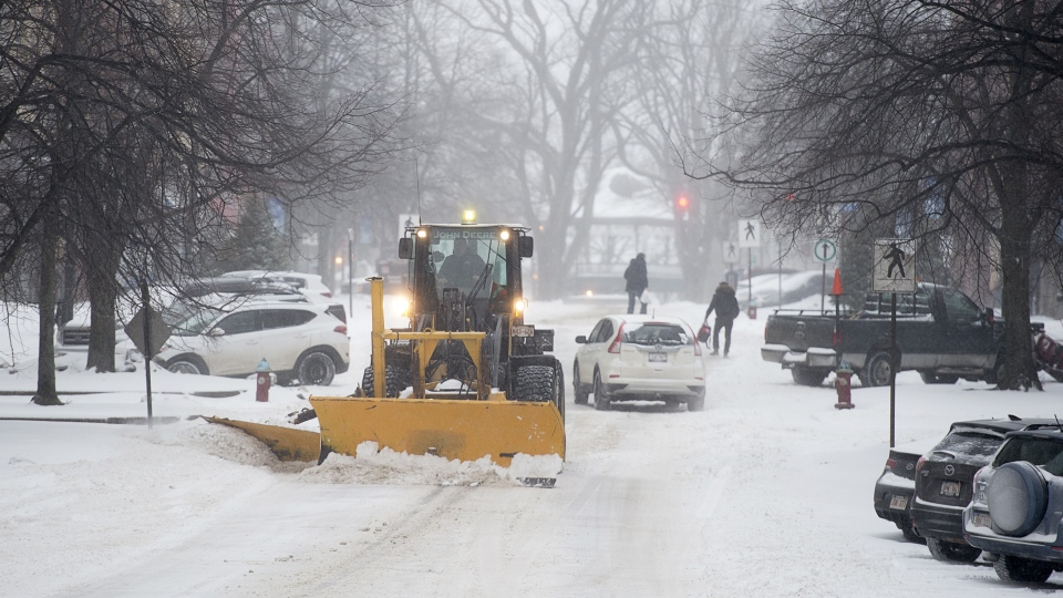 Residents brave the elements at the start of a major winter storm in Saint John, N.B. on Sunday, Jan. 20, 2019. (THE CANADIAN PRESS/Andrew Vaughan)