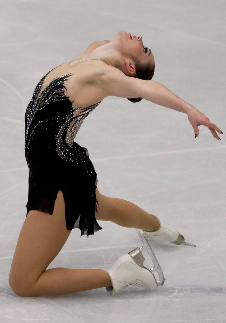 Kaetlyn Osmond of Canada performs during the women's free skating program, at the Figure Skating World Championships in Assago, near Milan, Italy, Friday, March 23, 2018. (AP Photo/Luca Bruno)