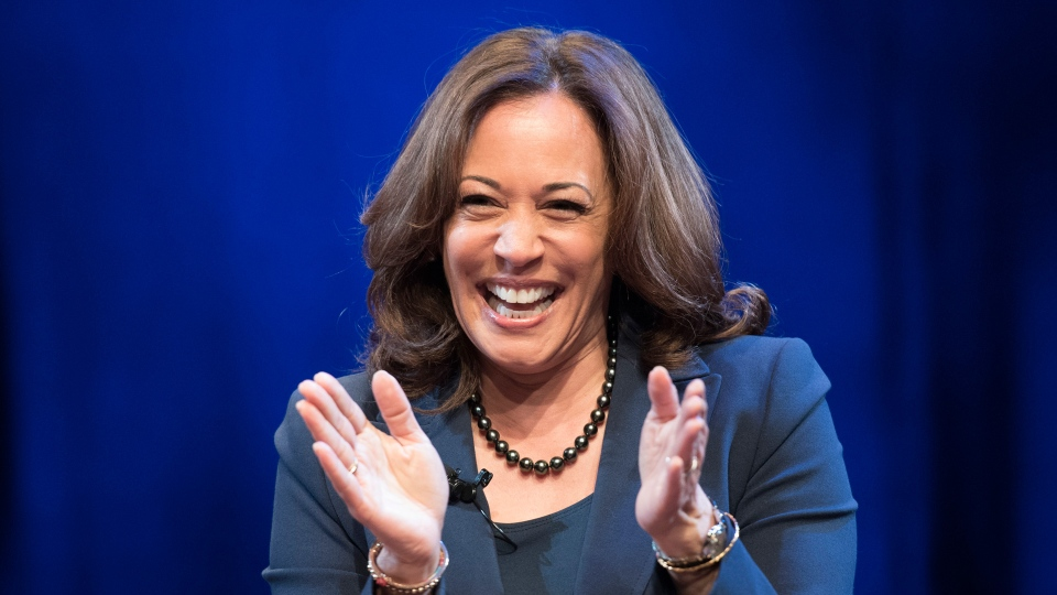 In this Jan. 9, 2019 photo, Sen. Kamala Harris, D-Calif., greets the audience at George Washington University in Washington, during an event kicking off her book tour. (AP Photo/Sait Serkan Gurbuz)