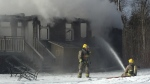 Firefighters work to extinguish a house fire in Tiny Township on Monday, Jan. 21, 2019 (CTV News/Steve Mansbridge)