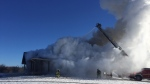 Crews work to extinguish a house fire in Ramara Township, Ont. on Jan. 21, 2019 (Photo Cred: Tony Stong, Fire Chief, Ramara Fire & Rescue Services)