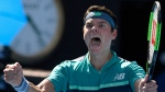 Canada's Milos Raonic celebrates after defeating Germany's Alexander Zverev in their fourth round match at the Australian Open tennis championships in Melbourne, Australia, Monday, Jan. 21, 2019. (AP Photo/Andy Brownbill)