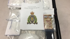 RCMP seized drugs and cash after a search warrant in Ardmore, Alta. (Supplied)