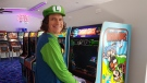 Matthew Russell is seen wearing a Luigi costume in the Short Circuit Arcade. (Adam Malcolm)