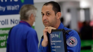 A Transportation Security Administration (TSA) employee works at a security checkpoint at Miami International Airport, Friday, Jan. 18, 2019, in Miami. (AP / Lynne Sladky)