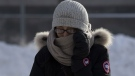 A woman holds her scarf in place as she crosses a downtown street Monday January 21, 2019 in Ottawa. Cold weather continued to affect the region with cold temperatures and windchill warnings in effect.THE CANADIAN PRESS/Adrian Wyld