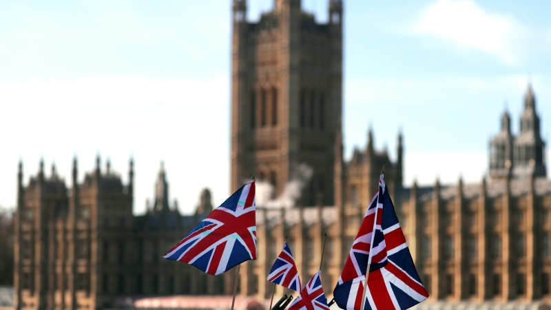 British Union flags fly in front of The Houses of Parliament in London, Tuesday, Jan. 22, 2019. (AP Photo/Frank Augstein)