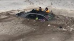 A mother says her instincts kicked in after her car slid off a road and into an icy pond.