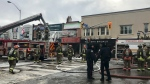 Crews work to contain a fire on Danforth Avenue near Chester on January 22, 2019. (Cristina Tenaglia/CP24)