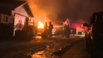 A vehicle and garage were heavily damaged in a fire on Tuesday morning.