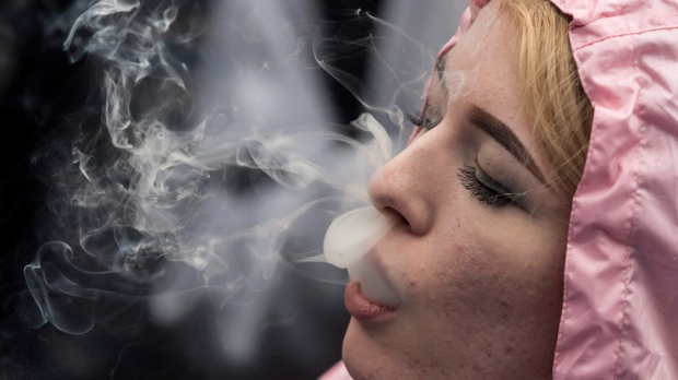 In this April 20, 2018 file photo, a woman exhales while smoking a joint during the 4-20 annual marijuana celebration, in Vancouver, British Columbia. (Darryl Dyck/The Canadian Press via AP, File)