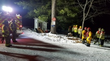 Emergency crews prepare to aid a young child following a snowmobile crash on an island on Kahshe Lake, Gravenhurst, Ont. on Monday, Jan. 21, 2019 (Photo cred: Gravenhurst Fire Chief Larry Brassard)
