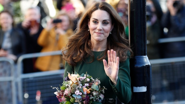 Kate, Duchess of Cambridge waves to a crowd of well-wishers after a visiting to the 'Family Action' charity in south in London, Tuesday, Jan. 22, 2019, where she helped launch a new national support line. (AP Photo/Alastair Grant)