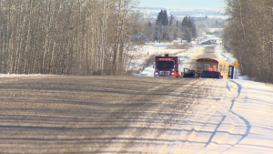 Police are investigating after a stolen truck collided with a bus carrying seven Penhold students Tuesday morning, and the truck driver fled in a second stolen vehicle he carjacked at the scene.