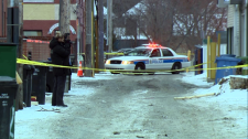 Police taped off an alley near Kensington Road N.W. to investigate after a suspicious death.