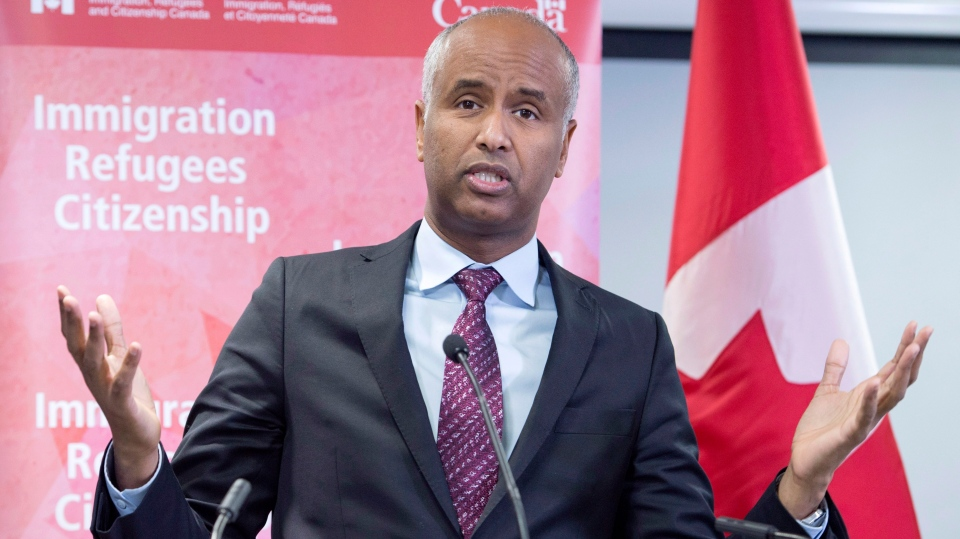 Minister of Immigration Ahmed Hussen makes an announcement of support for pre-arrival services at the YMCA in Toronto on Monday, January 14, 2019. THE CANADIAN PRESS/Frank Gunn