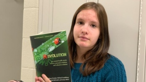 Orillia student Zoey Raffay, 18, holds the book Brainstorm Revolution that contains her personal story on mental health. (CTV News/Craig Momney)