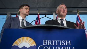 Federal Minister of Border Security and Organized Crime Reduction, Bill Blair speaks as British Columbia Attorney General, David Eby looks on during a news conference in Vancouver, Tuesday, Jan 22, 2019. THE CANADIAN PRESS/Jonathan Hayward