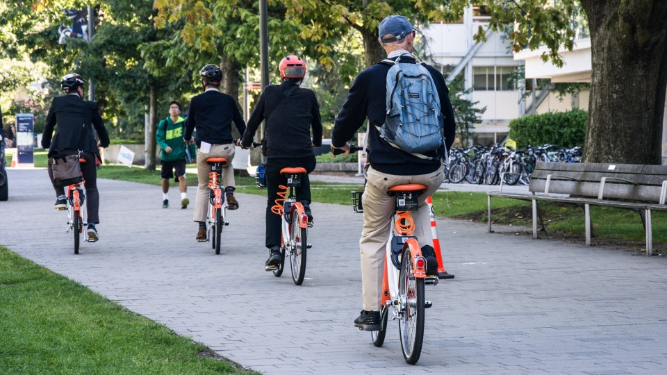 Drop Mobility bikes seen being ridden on UBC's Vancouver campus. (@dropmobility / Twitter)