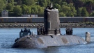 HMCS Windsor, one of Canada's Victoria-class long range patrol submarines, returns to port in Halifax on June 20, 2018. (The Canadian Press/Andrew Vaughan)