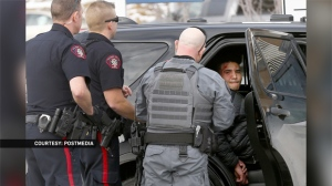 Suspect in police custody following the theft of a CPS vehicle on January 21, 2019. Matthew MacGugan has been charged in connection with the incident (Image: Postmedia)