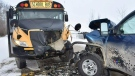 """RCMP in Alberta are searching for an """"armed and dangerous"""" man who collided with a school bus and stole the vehicle of a woman who stopped to help."""