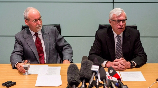 Sergeant-at-Arms Gary Lenz, left, and Clerk of the Legislative Assembly Craig James make a statement to media in Vancouver, B.C., on Monday November 26, 2018. (THE CANADIAN PRESS/Ben Nelms)