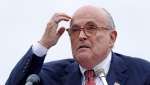 In this Aug. 1, 2018 file photo, Rudy Giuliani, an attorney for U.S. President Donald Trump, speaks in Portsmouth, N.H. (AP Photo/Charles Krupa, File )