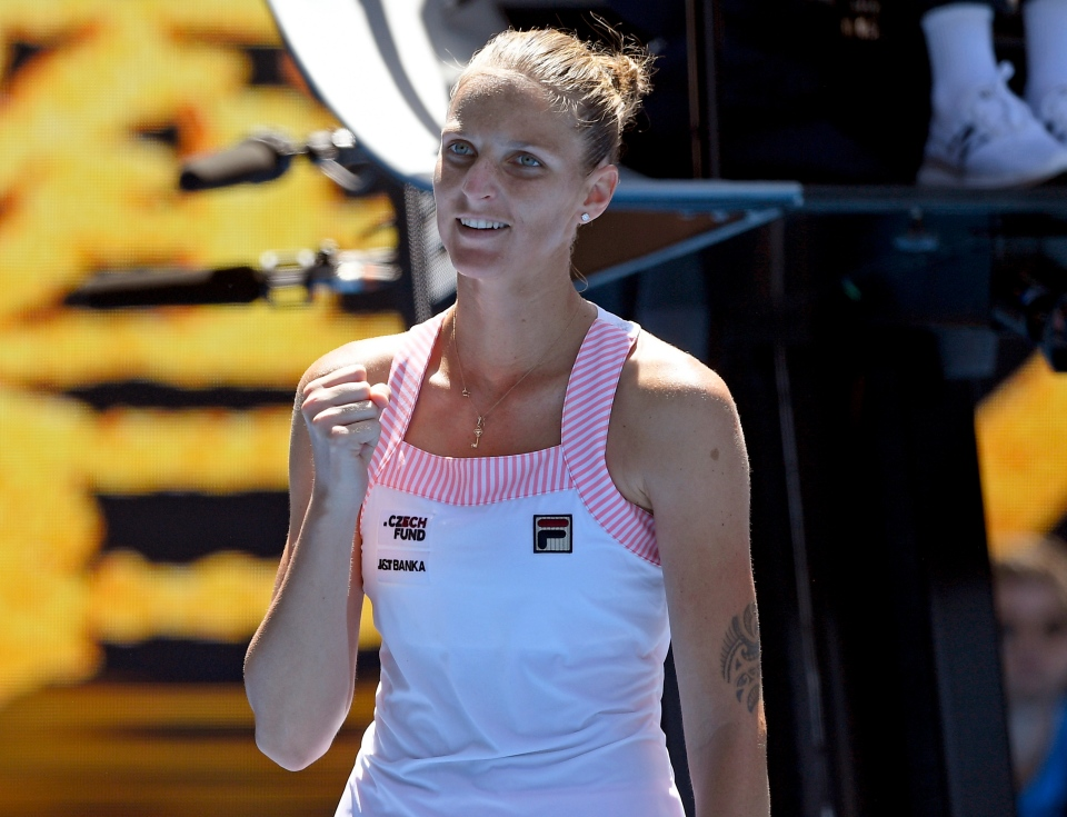 Karolina Pliskova of the Czech Republic reacts after winning her quarterfinal against United States' Serena Williams at the Australian Open tennis championships in Melbourne, Australia, Wednesday, Jan. 23, 2019. (AP Photo/Andy Brownbill)
