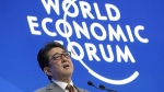 Japanese Prime Minister Shinzo Abe addresses the annual meeting of the World Economic Forum in Davos, Switzerland, on Jan. 23, 2019. (Markus Schreiber / AP)