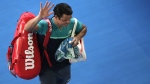 Milos Raonic waves as he leaves Rod Laver Arena following his quarterfinal loss to France's Lucas Pouille, on Jan. 23, 2019. (Kin Cheung / AP)