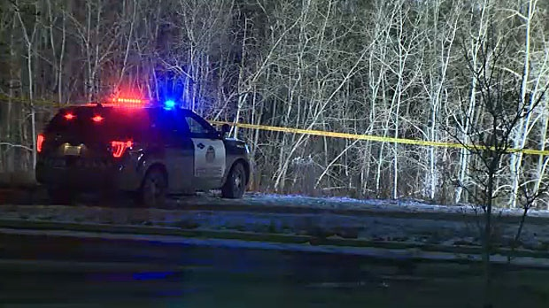 Police were brought to a wooded area in southwest Calgary late Tuesday night and say it has to do with a murder investigation that took place earlier in the day.