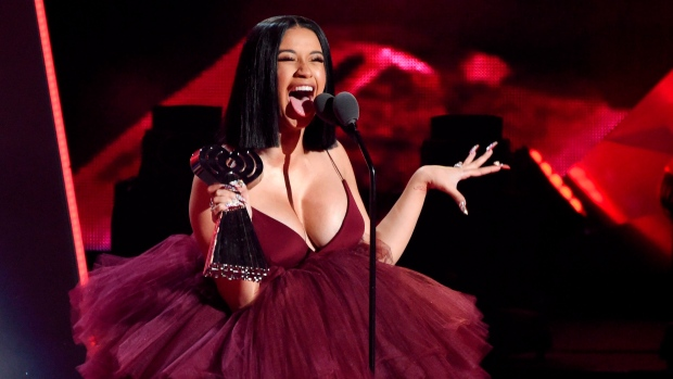 In this March 11, 2018, file photo, Cardi B accepts the Best New Artist award during the 2018 iHeartRadio Music Awards in Inglewood, Calif. (Photo by Chris Pizzello/Invision/AP, File)