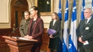 Public Security Minister Genevieve Guilbault, flanked by Sureté du Quebec police chief Martin Prud'homme, announces minor changes to Quebec's long-gun registry on Jan. 23, 2019 (CTV Montreal/Maya Johnson)