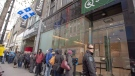 Customers lineup at a government cannabis store in Montreal on October 18, 2018. Quebec's cannabis agency generated about $40 million of sales in its first three months of operation, but supply shortages are forcing the public retailer to reduce its expansion plans. (THE CANADIAN PRESS/Ryan Remiorz)