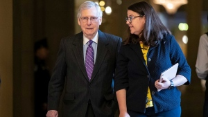 Senate Majority Leader Mitch McConnell, R-Ky., with Secretary for the Majority Laura Dove, right, walks to the chamber at the Capitol in Washington, Wednesday, Jan. 23, 2019. (AP Photo/J. Scott Applewhite)