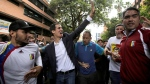 Juan Guaido waves at supporters after declaring himself interim president of the South American country, during a rally demanding the resignation of President Nicolas Maduro, in Caracas, Venezuela, Wednesday, Jan. 23, 2019. (AP Photo/Boris Vergara)