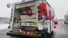 Police say the postal truck may have been trying to turn left when the crash happened. (@OPP_WR / Twitter)
