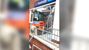 Builder destroys hotel lobby with digger